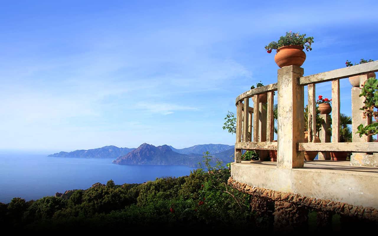 Hotel Les Roches Rouges Piana Corsica balkon met uitzicht